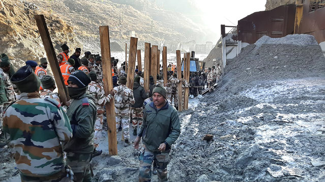 Indo Tibetan Border Police (ITBP) personnel undertake rescue work at one of the hydro power project at Reni village in Chamoli district, in Indian state of Uttrakhund, Monday, February 8, 2021. Rescue efforts continued on Monday to save 37 people after part of a glacier broke off, releasing a torrent of water and debris that slammed into two hydroelectric plants on Sunday. (Photo by AP Photo/Stringer)