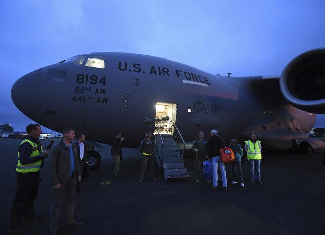 U.S. Secretary of State John Kerry, third right, prepares to board U.S. Air Force C-17 flight to Antarctica at Christchurch International Airport, New Zealand Friday, November 11, 2016. (Photo by Mark Ralston/Pool Photo via AP Photo)