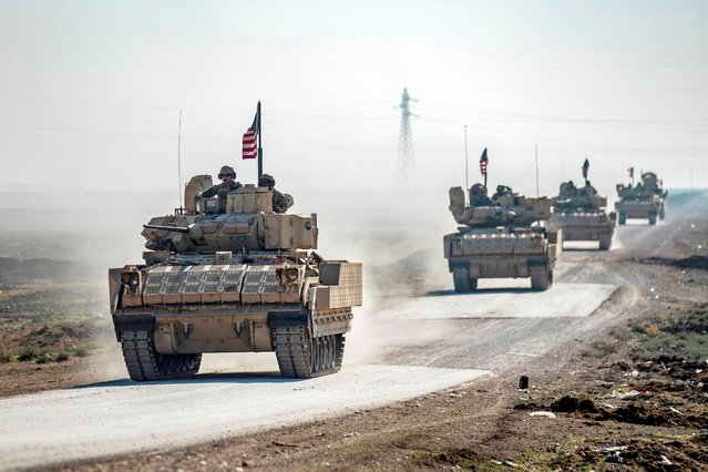 A US IFV convoy patrols near the village of Tal Alo, in the Yarubiyah district of Syria's northeastern Hasakah province near the M4 highway, on November 18, 2020. (Photo by Delil Souleiman/AFP Photo)