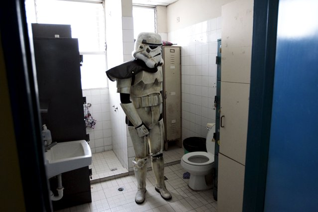 A cosplayer dressed as a Storm Trooper from the Star Wars movie series is pictured in a restroom during a charity event organised by the El Salvador Star Wars fan club at the Benjamin Bloom National Children's Hospital in San Salvador, El Salvador December 14, 2015. (Photo by Jose Cabezas/Reuters)