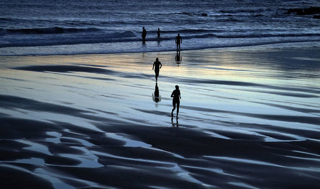 Swimmers take to the freezing North Sea at King Edwards Bay near Tynemouth, United Kingdom on New Years Eve, December 31, 2020. (Photo by Owen Humphreys/PA Images via Getty Images)