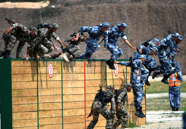 Chinese marines compete during an obstacle course of the Seaborne Assault contest as part of the International Army Games 2018 on July 30, 2018 in Quanzhou, Fujian Province of China. (Photo by VCG via Getty Images)