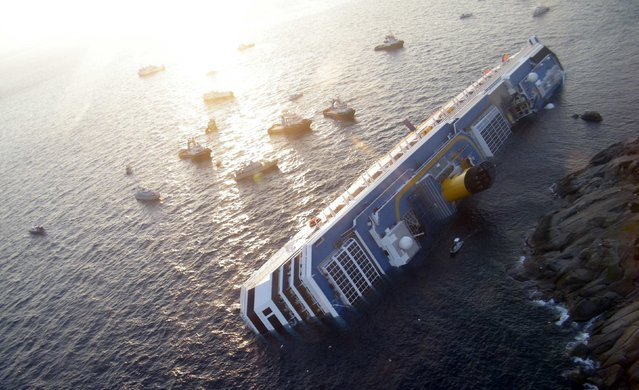 Costa Concordia cruise ship that ran aground is seen off the west coast of Italy at Giglio island in this January 14, 2012 file photo. (Photo by Reuters/Italian Guardia di Finanza)