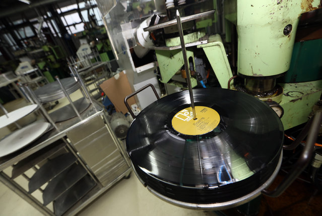 A machine presses a Doors album at the Optimal record plant on February 11, 2015 in Roebel, Germany. According to industry data, over 9 million vinyl records, 19th century analog technology appreciated for its audio quality and durability, were sold in the U.S. in 2014, up 52% from the same period the previous year, having hit a low of 300,000 per annum in 1993. (Photo by Adam Berry/Getty Images)