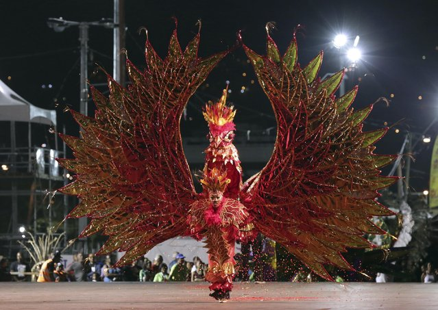 "Ryan Sooknanan portraying ""Phoenix"" performs in the Junior Carnival King competition put on by the National Carnival Commission at the Queen's Park Savannah, Port-of-Spain, February 13, 2015. Picture taken February 13, 2015. (Photo by Andrea De Silva/Reuters)"
