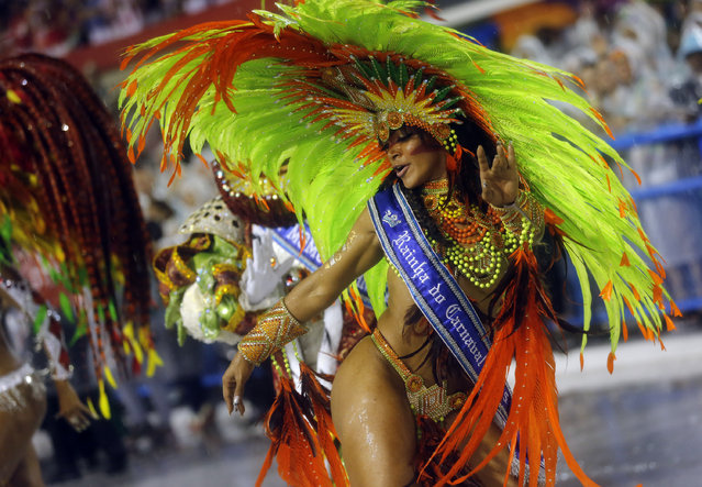 A performer from the Mangueira samba school dances in the Carnival parade, at the Sambadrome in Rio de Janeiro, Sunday, February 15, 2015. (Photo by Silvia Izquierdo/AP Photo)