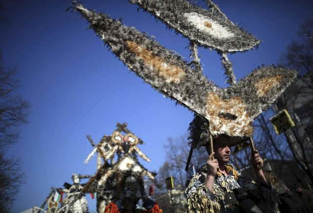 Participants in traditional costumes attend the International Festival of the Masquerade Games in the town of Pernik, Bulgaria January 30, 2016. (Photo by Stoyan Nenov/Reuters)