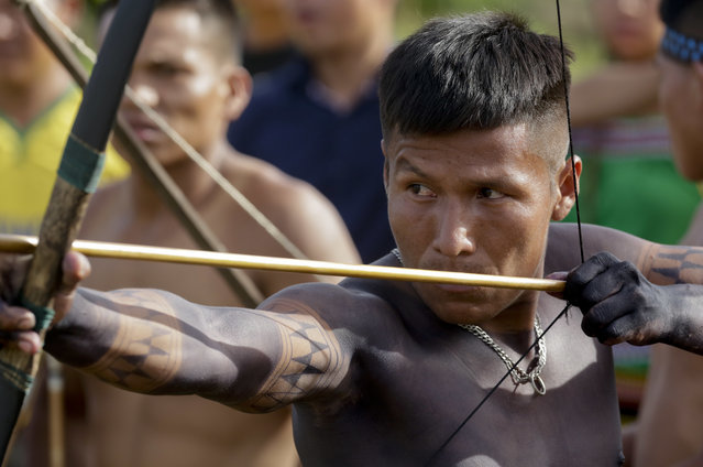In this November 26, 2018 photo, an Embera indigenous man takes part in the bow and arrow competition during the second edition of the Panamanian indigenous games in Piriati, Panama. Panama attended the first World Indigenous Peoples Games in Brazil in 2015 and participated in the next one in Canada in 2017. (Photo by Arnulfo Franco/AP Photo)