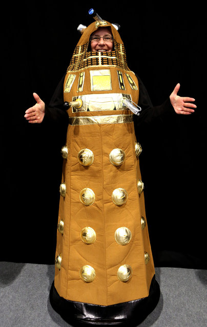 Wendy Taylor from Harwich, Essex, dresses as a Dalek cduring a visit to the Doctor Who Official 50th Celebration at the London Excel Centre Docklands, on November 22, 2013. (Photo by Chris Radburn/PA Wire)