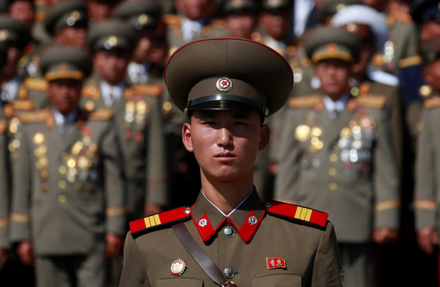 A soldier wears a badge with portraits of late North Korean leaders Kim Il Sung and Kim Jong Il as he attends a military parade marking the 70th anniversary of North Korea's foundation in Pyongyang, North Korea, September 9, 2018. (Photo by Danish Siddiqui/Reuters)