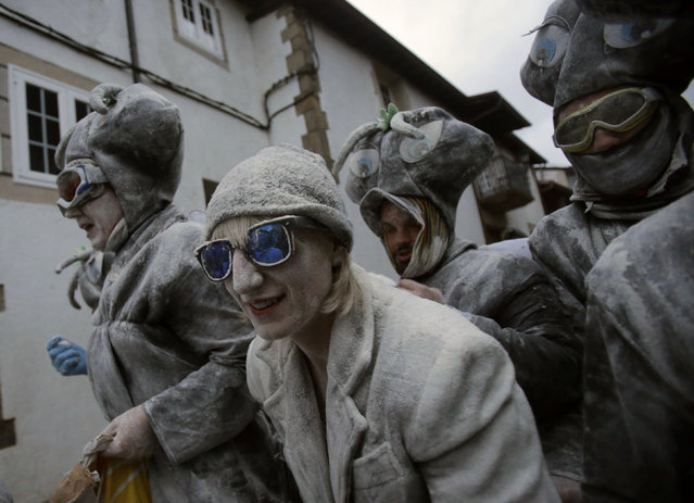 """Revellers participate in a flour fight during the """"O Entroido"""" festival in Laza village, Spain February 8, 2016. (Photo by Miguel Vidal/Reuters)"""