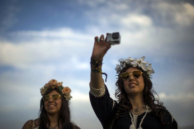 Women record GoPro video at the Coachella Valley Music and Arts Festival in Indio, California April 10, 2015. (Photo by Lucy Nicholson/Reuters)