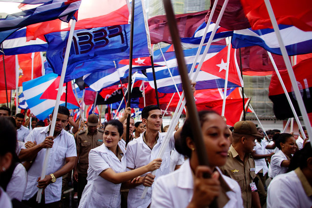 Medical students and members of the military march during a ceremony marking the 147th anniversary of the deaths of student leaders killed during the fight against Spanish colonial rule, Havana, Cuba, November 27, 2018. (Photo by Alexandre Meneghini/Reuters)