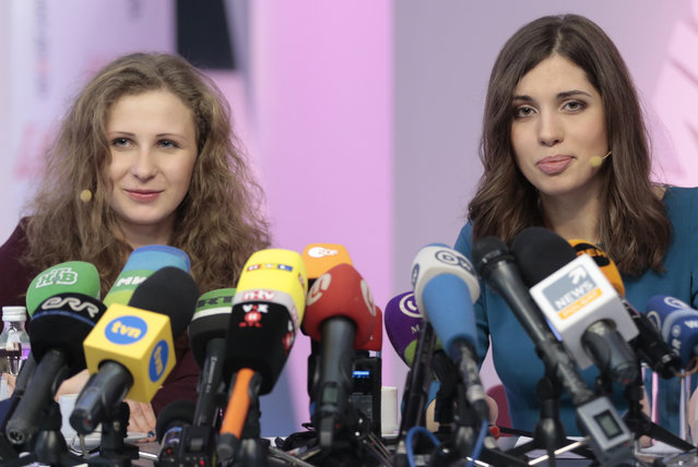 Russian punk band p*ssy Riot members Nadezhda Tolokonnikova, right, and Maria Alekhina smile during their news conference in Moscow, Russia, on Friday, December 27, 2013. Tolokonnikova and Alekhina were granted amnesty on Monday, December 23, two months short of their scheduled release after spending nearly two years in prison for their protest at Moscow's main cathedral. (Photo by Ivan Sekretarev/AP Photo)