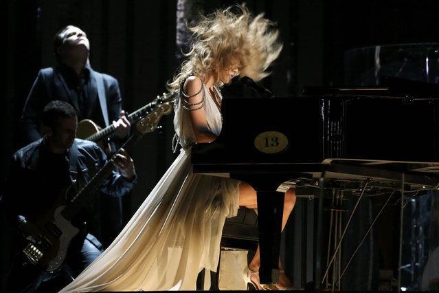 "Taylor Swift performs ""All Too Well"" at the 56th annual Grammy Awards in Los Angeles, California January 26, 2014. (Photo by Mario Anzuoni/Reuters)"