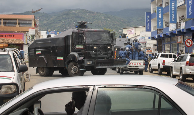 Burundian riot police and a police water cannon truck patrol following clashes with opposition protesters in a street in the capital Bujumbura, Burundi Sunday, April 26, 2015. (Photo by Eloge Willy Kaneza/AP Photo)