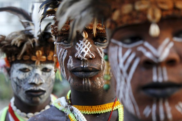 Members of the panther men of Liabo village, an  Ivorian traditional dance group, pose as they prepare to perform  at the MASA (Market for African Performing Arts) at the culture palace of Abidjan March 10, 2016. (Photo by Luc Gnago/Reuters)