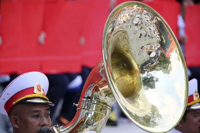 A Vietnamese soldier in the military band plays during a parade celebrating the 40th anniversary of the end of the Vietnam War which is also remembered as the fall of Saigon, in Ho Chi Minh City, Vietnam, Thursday, April 30, 2015. (Photo by Na Son Nguyen/AP Photo)