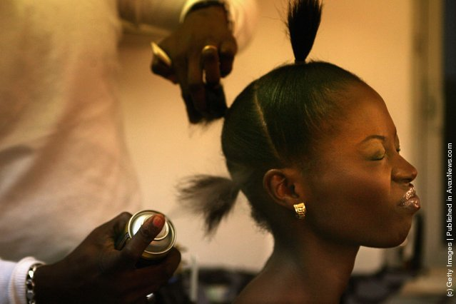 Nigerian fashion models are made up for their fashion show to promote ethnic fashion June 13, 2006 in Tel Aviv, Israel. The models said they hope to use the travelling show as a springboard to international fame, in the words of one, to be the next Naomi Campbell