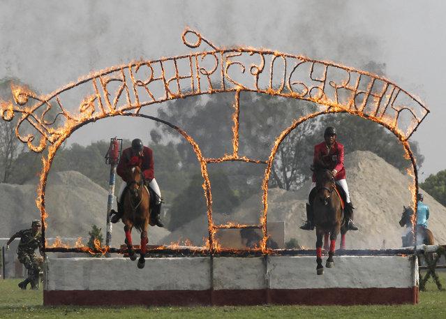 In this April 4, 2019, photo, Nepalese cavalry soldiers display their skills during the Ghode Jatra festival in Kathmandu, Nepal. (Photo by Niranjan Shrestha/AP Photo)