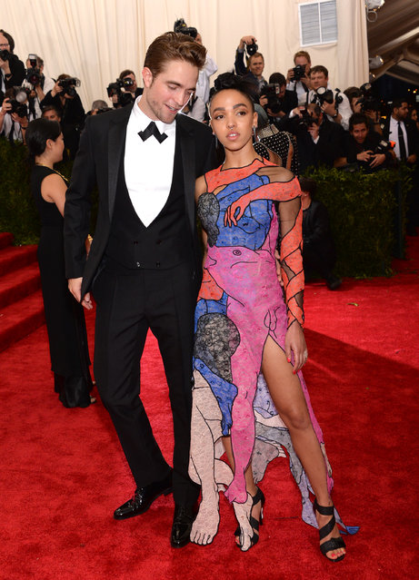 "Robert Pattinson, left, and FKA Twigs arrive at The Metropolitan Museum of Art's Costume Institute benefit gala celebrating ""China: Through the Looking Glass"" on Monday, May 4, 2015, in New York. (Photo by Evan Agostini/Invision/AP Photo)"