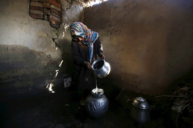 A Kashmiri woman fills a pot with water after collecting it from a river in Pattan, north of Srinagar, the summer capital of Indian Kashmir, 22 March 2016. World Water Day is observed on 22 March every year. World Water Day is an international observance and an opportunity to learn more about water related issues, be inspired to tell others and take action to make a difference. (Photo by Farooq Khan/EPA)