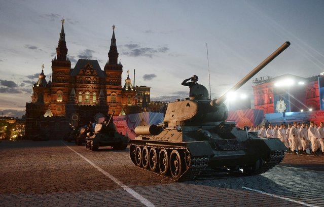 Soviet World War Two T-34 tanks drive during a festive concert marking the 70th anniversary of the end of World War Two in Europe, at Red Square in Moscow, Russia, May 9, 2015. (Photo by Reuters/Host Photo Agency/RIA Novosti)