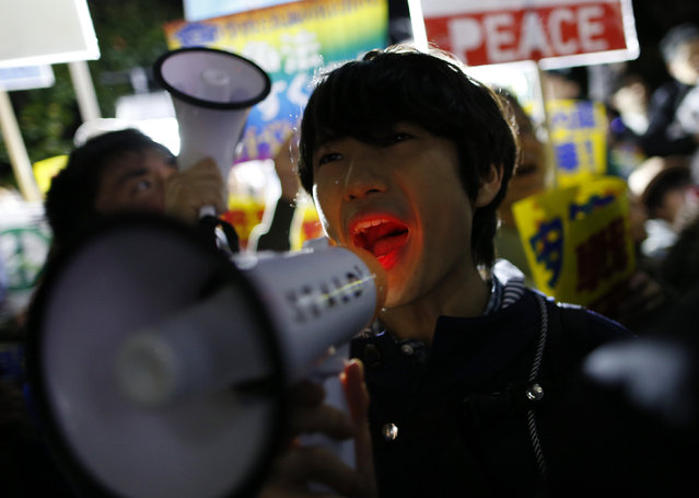 A protester holding a loudhailer shouts slogans during a rally against Japan's Prime Minister Shinzo Abe's security legislation and his administration in front of the parliament in Tokyo, Japan, March 29, 2016. (Photo by Yuya Shino/Reuters)