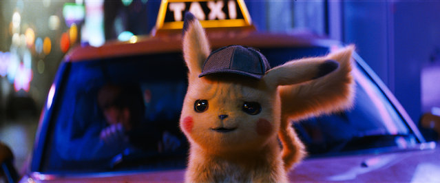"This image released by Warner Bros. Pictures shows the character Detective Pikachu, voiced by Ryan Reynolds, in a scene from ""Pokemon Detective Pikachu"". (Photo by Warner Bros. Pictures via AP Photo)"