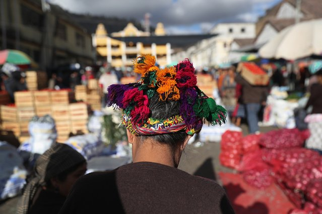 A woman, wearing traditional Mayan dress, shops at a vegetable market on February 11, 2017 in Almolonga, Guatemala. (Photo by John Moore/Getty Images)