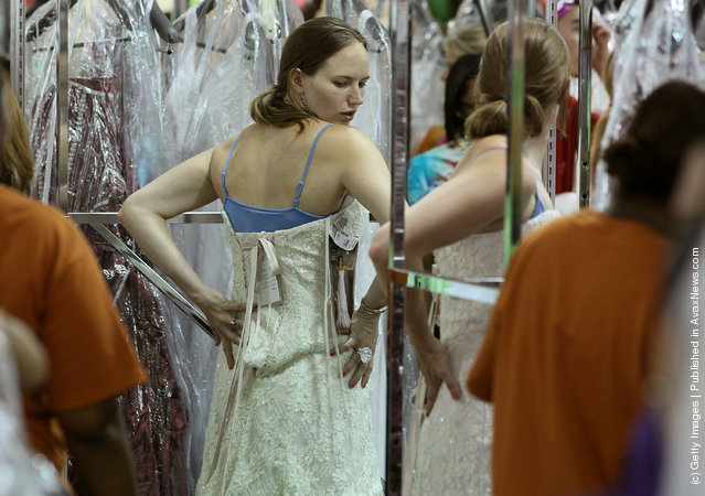 A future bride tries on a wedding gown during Filene's Basement's annual sale