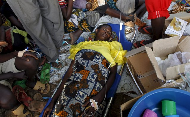A sick Burundian refugee waits for treatment at a makeshift clinic on the shores of Lake Tanganyika in Kagunga village in Kigoma region in western Tanzania, as they wait for MV Liemba to transport them to Kigoma township, May 17, 2015. (Photo by Thomas Mukoya/Reuters)