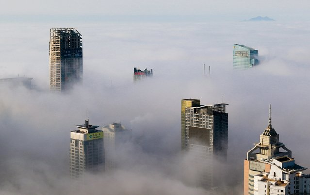 Buildings are seen among fog in Qingdao, Shandong province, China in this March 27, 2015 file photo. (Photo by Reuters/Stringer)