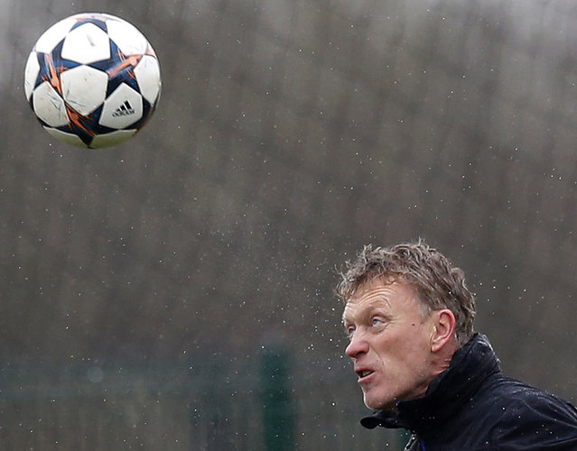 Manchester United's manager David Moyes heads a ball during a training session at the club's Carrington training complex in Manchester, northern England March 18, 2014. United are set to play Greek side Olympiakos in the Champions League on Wednesday. (Photo by Phil Noble/Reuters)