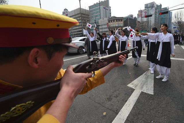 South Korean activists dressed as colonial-era Japanese soldiers reenact a crackdown of the independence movement during celebrations of the 98th Independence Movement Day in Seoul on March 1, 2017. South Korea on March 1 marked the anniversary of the country's 1919 uprising against the 1910-1945 Japanese colonial rule. (Photo by Jung Yeon-Je/AFP Photo)