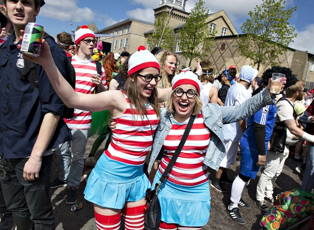 People take part in the Grand Parade of Aalborg Carnival in Aalborg, Denmark May 23, 2015. (Photo by Henning Bagger/Reuters/Scanpix Denmark)