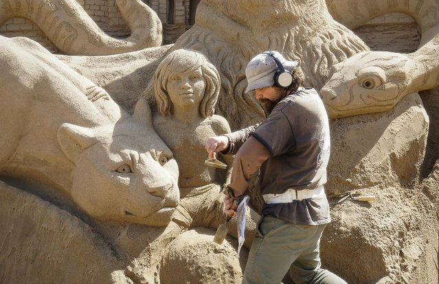 """Dmitry Klimenko of Russia works on his creation during the Sand Sculpture Festival """"Sand Fantasy"""" in Almaty, Kazakhstan, April 15, 2016. (Photo by Shamil Zhumatov/Reuters)"""