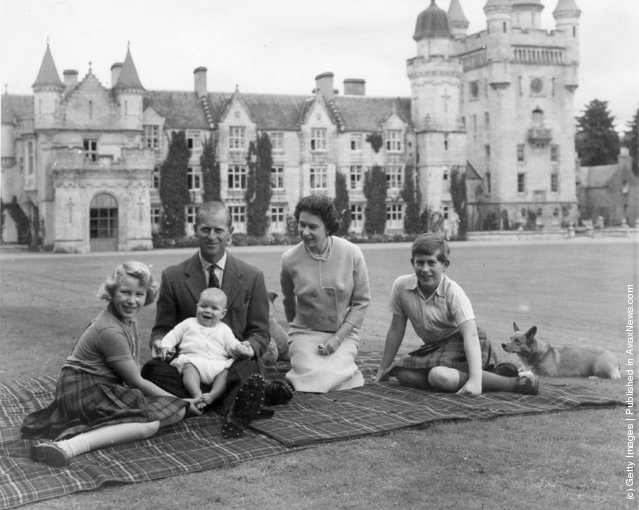 1960: Queen Elizabeth II and Prince Philip, Duke of Edinburgh with their children, Prince Andrew (centre), Princess Anne (left) and Charles, Prince of Wales sitting on a picnic rug outside Balmoral Castle in Scotland