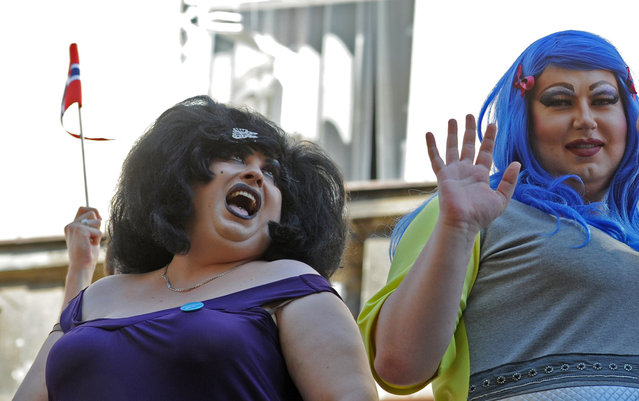 "Drag queens sing during the annual gay pride parade in Warsaw, Poland, Saturday, June 13, 2015. Gay rights activists hold their 15th yearly ""Equality Parade"" as Poland slowly grows more accepting of gays and lesbians, but where gay marriage, and even legal partnerships, still appear to be a far-off dream. This year's parade comes amid a right-wing political shift, a possible setback for the LGBT community. (AP Photo/Alik Keplicz)"