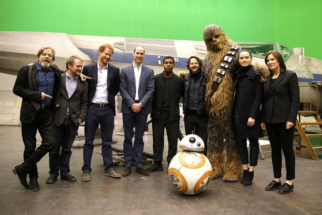 (L-R) US actor Mark Hamill, US director Rian Johnson, Britain's Prince Harry, Britain's Prince William, Duke of Cambridge, British actor John Boyega, Chewbacca and British actress Daisy Ridley pose during a tour of the Star Wars sets at Pinewood studios in Iver Heath, west of London, Britain on April 19, 2016. (Photo by Adrian Dennis/Reuters)