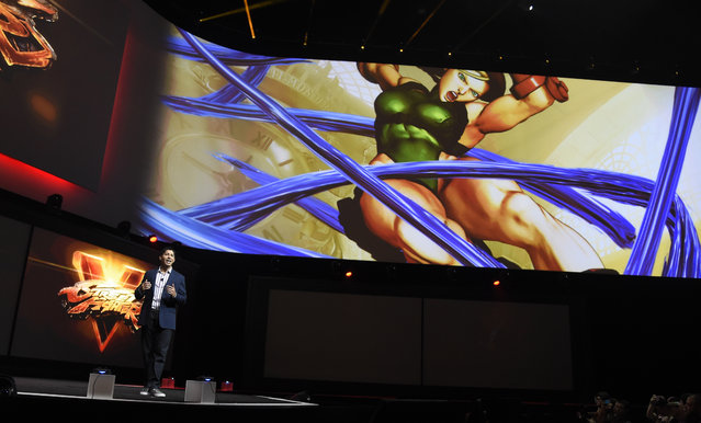 """Asad Qizilbash, head of software marketing for Sony Computer Entertainment America, discusses the video game """"Street Fighter V"""" during the Sony Playstation at E3 2015 news conference at the Los Angeles Sports Arena on Monday, June 15, 2015, in Los Angeles. (Photo by Chris Pizzello/Invision/AP)"""