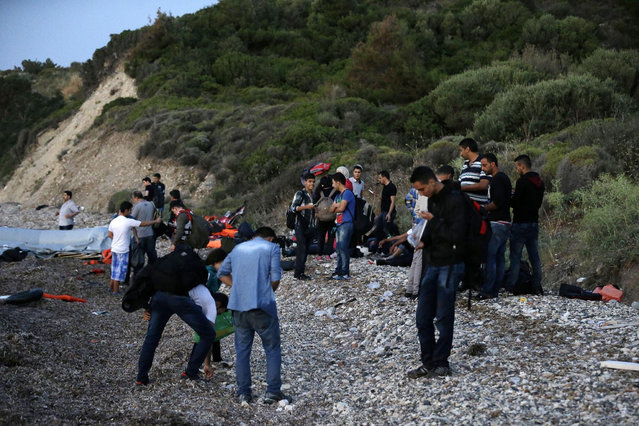 Syrian migrants arrive at a beach in Mytilene, on the northeastern Greek island of Lesvos, early Tuesday, June 16, 2015. Lesvos has been bearing the brunt of a huge influx of migrants from the Middle East, Asia and Africa crossing from the Turkish coast to nearby Greek islands. More than 50,000 migrants have arrived in Greece already this year, compared to 6,500 in the first five months of last year. (AP Photo/Thanassis Stavrakis)
