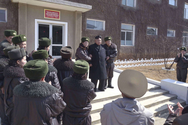 North Korean leader Kim Jong Un receives applause as he supervises a flight drill of the KPA Air and Anti-Air Force Unit 2620, honored with the Title of O Jung Hup-led 7th Regiment, in this undated photo released by North Korea's Korean Central News Agency (KCNA) March 7, 2014. (Photo by Reuters/KCNA)