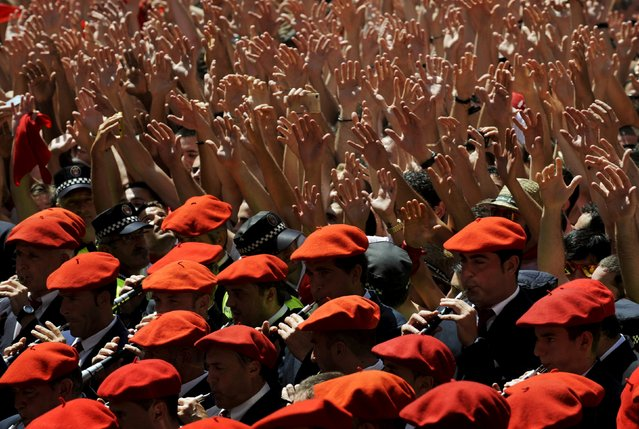 The municipal band plays during the start of the San Fermin festival in Pamplona, Spain, July 6, 2015. (Photo by Eloy Alonso/Reuters)