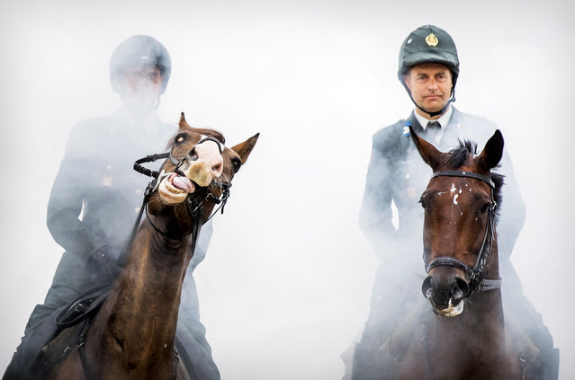 Members of the Cavalry honorary escort practice on the beach for Prinsjesdag, on September 16, 2019 in Scheveningen. The horses and riders involved are subjected to a final heavy test by exposing them to gunfire, cannon blows, music, smoke and possible public reactions. (Photo by Koen van Weel/ANP/AFP Photo)