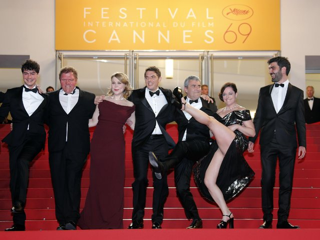"""Director Alain Guiraudie (3rdR) poses on the red carpet with cast members ahead of the screening of the film """"Rester vertical"""" (Staying Vertical) in competition during the 69th Cannes Film Festival in Cannes, France, May 12, 2016. (Photo by Jean-Paul Pelissier/Reuters)"""