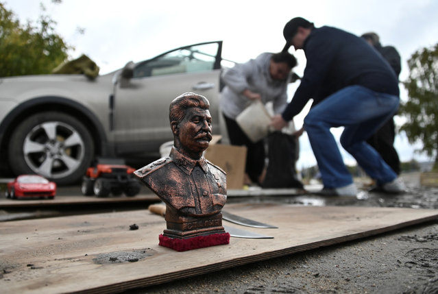 A bust of Soviet leader Josef Stalin is displayed for sale at a local flea market in the Siberian city of Omsk, Russia on September 29, 2019. (Photo by Alexey Malgavko/Reuters)