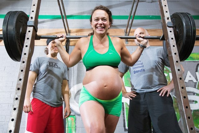 Meghan Umphres Leatherman, 9 months pregnant and dilated to 1cm seen lifting a heavy weight at her home town gym in Phoenix, Arizona. (Photo by Dave Cruz/Barcroft Media)