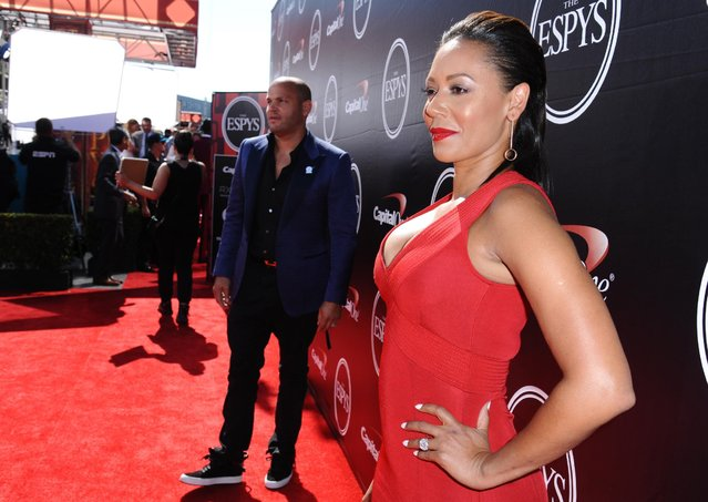 "Melanie Brown ""Mel B"", right, and Stephen Belafonte, background, arrive at the ESPY Awards at the Microsoft Theater on Wednesday, July 15, 2015, in Los Angeles. (Photo by Richard Shotwell/Invision/AP Photo)"