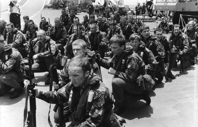 Royal Marines waiting on the flight deck of HMS Hermes for Sea King helicopters to take them on training manoeuvres, April 1982
